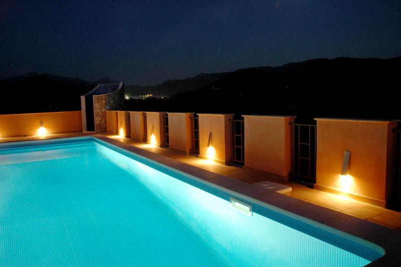 Architecture mallorca understatement finca for Pool design lighting